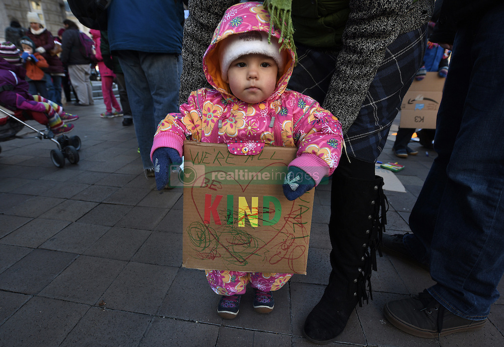 """December 10, 2016 - Washington, DC, USA - VIVIENNE BAKER, 19 months old, makes a sign. Children's Rally for Kindness takes place at Trump International Hotel in Washington DC on December 10, 2016 organized by the Takoma Parents Action Coalition.  According to their FaceBook page, it was a call to President-elect Donald Trump: ''to remember these lessons as he prepares to take office and implement policies that will affect the lives of children and families across our diverse nation.''.''All over the world, across cultures and countries, children learn the same basic lessons: .Ã'be kind,Ã"""" .Ã'tell the truth,Ã"""" .Ã'be fair,Ã"""" .Ã'respect everyone,Ã"""" .Ã'treat others the way you want to be treated,Ã"""" .Ã'donÃ•t touch others if they donÃ•t want to be touched. (Credit Image: © Carol Guzy via ZUMA Wire)"""