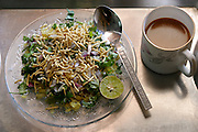 The Patkar family's vegetarian breakfast consists of rice flakes, chickpea-flour noodles and fresh chopped greens, Ujjain, India. (From a photographic gallery of meals in Hungry Planet: What the World Eats, p. 245). The Patkar family of Ujjain, Madhya Pradesh, India, is one of the thirty families featured, with a weeks' worth of food, in the book Hungry Planet: What the World Eats.