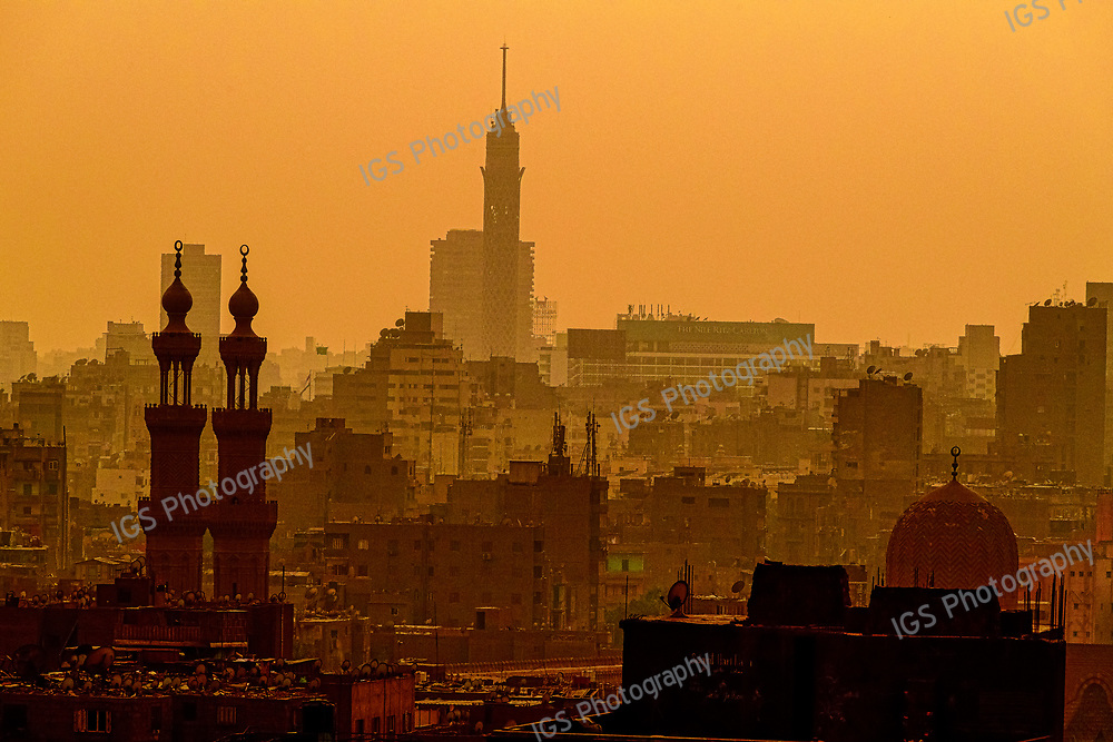 Cairo Skline at Dusk from Al-Azhar Park. The polluted air intensifies the colors of the sky