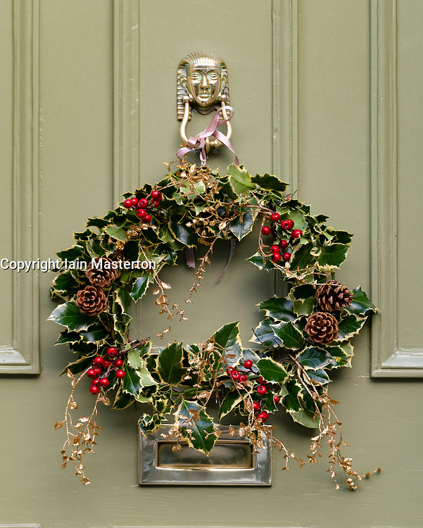 Detail of traditional Christmas wreath on front door of house in New Town of Edinburgh, Scotland, UK