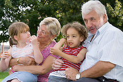 Family sitting together in the park,