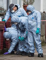© Licensed to London News Pictures. 03/04/2018. London, UK. Members of a police search team perform a fingertip search at the scene on Chalgrove Road, Tottenham, north London where a 17 year old girl was shot dead. The girl was found with a bullet wound and pronounced dead at the scene at 21:43 last night. Photo credit: Ben Cawthra/LNP