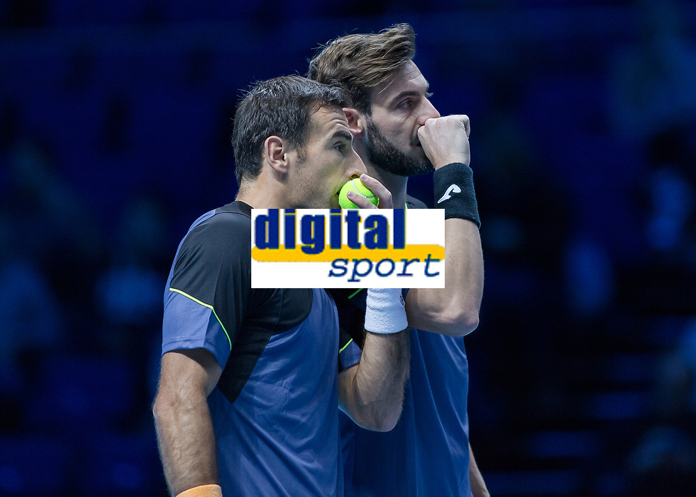 Tennis - 2017 Nitto ATP Finals at The O2 - Day Two<br /> <br /> Mens Doubles: Group Woodbridge/Woodforde: Lukasz Kubot (Poland) & Marcelo Melo (Brazil) Vs Ivan Dodig (Croatia) & Marcel Granollers (Spain)<br /> <br /> Ivan Dodig (Croatia) and Marcel Granollers (Spain) chat secretively about their next play at the O2 Arena<br /> <br /> COLORSPORT/DANIEL BEARHAM