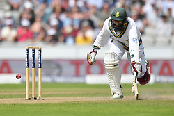 South Africa's Hashim Amla avoids a run-out during day two of the Fourth Investec Test at Emirates Old Trafford, Manchester.