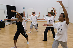 Dance teacher instructing a student during an auditioning for a dance performance,