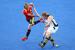 Ramon Alegre of Spain battles with Jonathan Robinson of South Africa Hockey during Pool MA  match between South Africa and Spain held at the Riverbank Arena in Olympic Park in London as part of the London 2012 Olympics on the 3rd August 2012..Photo by Ron Gaunt/SPORTZPICS