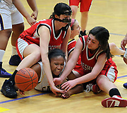 Class LL tourney, girls basketball, Cheshire at Career. Career's Bria Moore is sandwiched between Cheshire's Lauren DeBisschop left and Melissa Bailey right. Photo by Mara Lavitt/New Haven Register<br /> <br /> 3/4/11