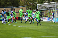 Forest Green Rovers Omar Bugiel(11) heads the ball Chester's Elliott Durrell(10) clears off the line during the Vanarama National League match between Forest Green Rovers and Chester FC at the New Lawn, Forest Green, United Kingdom on 14 April 2017. Photo by Shane Healey.