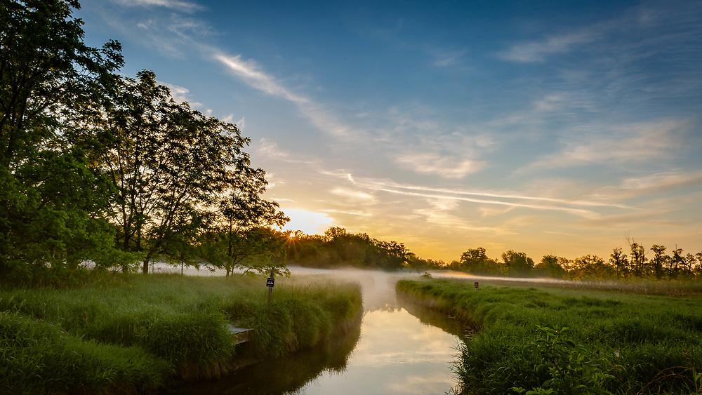 Daybreak, Nine Springs E-Way, misty morning view near canoe launch off Rimrock Road, Madison, Wisconsin. Photo taken June 2, 2021.
