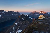 Summit camp on Helvetestind mountain peak, Moskenesøy, Lofoten Islands, Norway