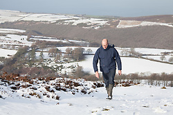 ***CAPTION CORRECTION***© Licensed to London News Pictures. 14/01/2015. Wheddon Cross, Somerset, UK. A man walking on Dunkery Hill in Exmoor National Park, Somerset this morning, 14th January 2015. Snow has fallen overnight across many parts of England, causing travel disruption in some areas.  Photo credit : Rob Arnold/LNP