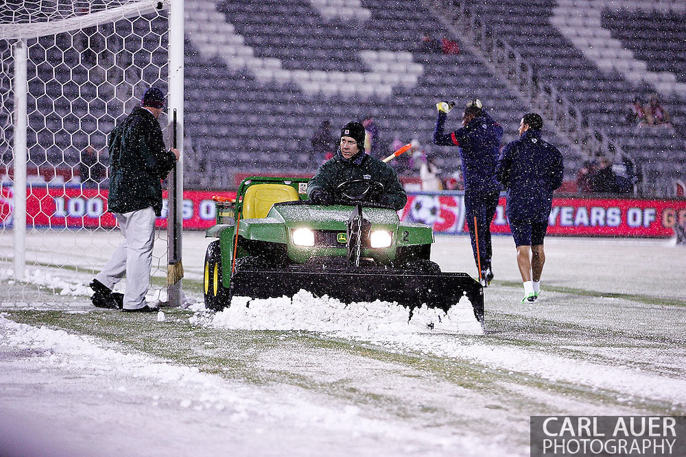 March 22nd, 2013 Commerce City, CO - The Colorado Rapids grounds crew clear the field of snow prior to the start of action in the World Cup qualifying match between Costa Rica and the USA Men's National Team at Dick's Sporting Goods Park in Commerce City, CO