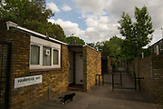 A cat on Hambridge Way in Cressingham Gardens on 30th May 2015 in South London, United Kingdom. Cressingham Gardens is a council garden estate, located on the southern edge of Brockwell Park. It comprises of 306 dwellings and built to the design of Lambeth Borough Council architect Edward Hollamby in the early 1970s. In 2012, Lambeth Council proposed regeneration of the estate, a decision highly opposed by many residents. Since the announcement, the highly motivated campaign group Save Cressingham Gardens has been active.