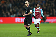 Referee Mike Dean looking on. Premier league match, West Ham Utd v Manchester Utd at the London Stadium, Queen Elizabeth Olympic Park in London on Monday 2nd January 2017.<br /> pic by John Patrick Fletcher, Andrew Orchard sports photography.