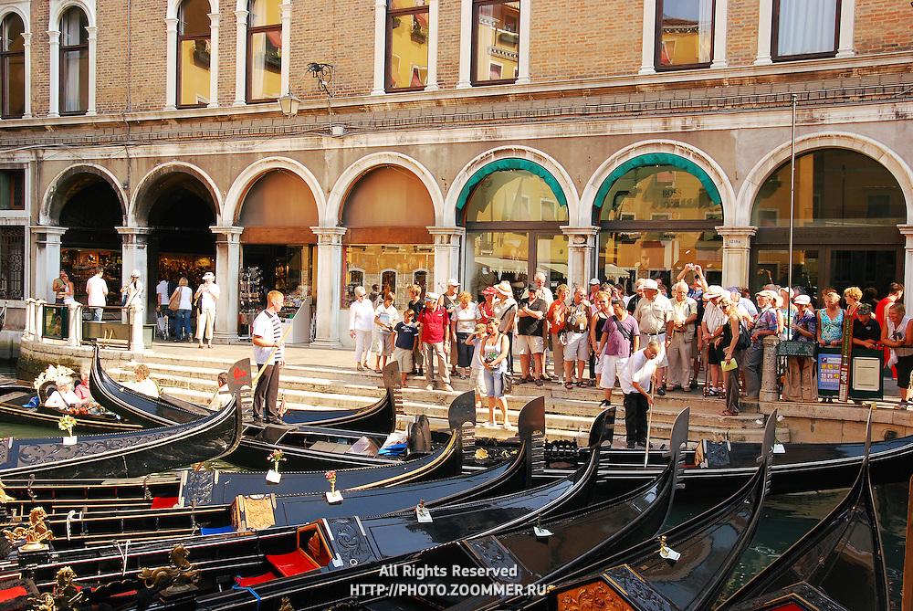 Gondolas parking in Venice. Tourists choose gondolas for traditional venetian gondola ride. Bacino Orseolo