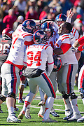Oct 27, 2012; Little Rock, AR, USA; The Ole Miss Rebels team reacts after  Bryson Rose (81) kicked a field goal to win the game during the second half of a game against the Arkansas Razorbacks at War Memorial Stadium. Ole Miss defeater Arkansas 30-27.  Mandatory Credit: Beth Hall-US PRESSWIRE