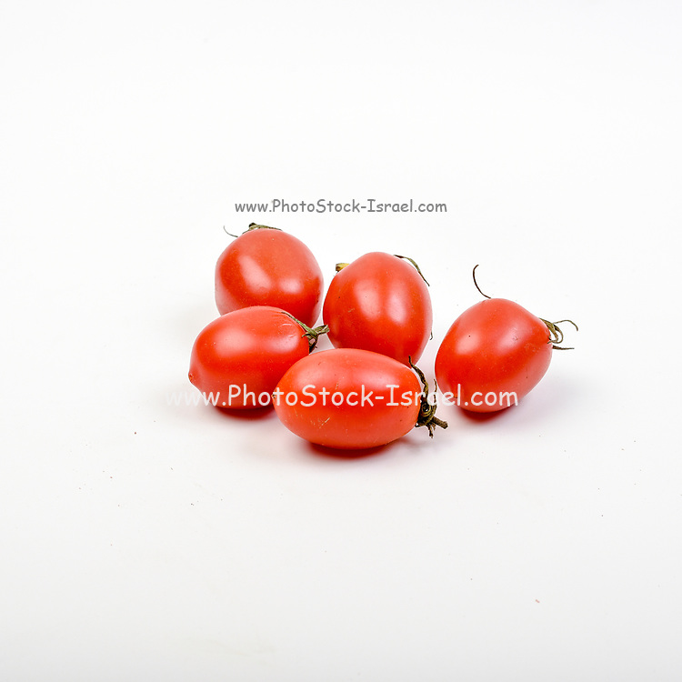 Fresh and organic tomatoes on white background