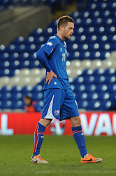 Gylfi Thor Sigurdsson (Tottenham Hotspur) of Iceland cuts a dejected figure after losing to Wales 2 - 1 - Photo mandatory by-line: Dougie Allward/JMP - Tel: Mobile: 07966 386802 03/03/2014 -