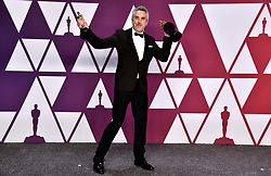 Alfonso Cuaron with his Best Director, Best Foreign Film and Best Cinematography Oscars for Roma in the press room at the 91st Academy Awards held at the Dolby Theatre in Hollywood, Los Angeles, USA.