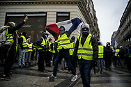A protester showing a French falg. More than 125000 gathered in Paris for the Gilets Jaune (Yellow vest) protest. Soon the protest turned violent an protesters clashed with the police, tear gas and flash bombs were fired, many injured and arrested by the police. Paris December 6th 2018. Federico Scoppa