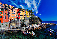 """""""Vibrant colored Southern Mediterranean view of Riomaggiore""""…<br /> <br /> I began my daily journey at the northern most town of Monterosso and took the train to the southernmost town of Riomaggiore. Upon arriving in this picturesque seaside village and moving down to the water's edge, I noticed proprietor Francesco in front of a tiny boat rental sign.  After arranging an evening sail up the coast, I was able to focus on the colorful persona of Riomaggiore. That evening I sailed up the coast photographing each Cinque Terre town along the way aboard the Angelina Dada. Upon arriving back home in Monterosso, soft light illuminated the sky and azure sea of the Mediterranean convincing me to sail all the way back to Riomaggiore with my gracious guides Claudio and Eddie of """"Cinque Terre dal Mare"""" sailing excursions. We arrived just in time for a perfect sunset. After a nice dinner...I caught the last train at midnight back home to Monterosso. A very long day, but worth every minute!"""