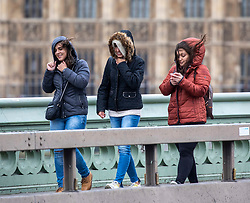 © Licensed to London News Pictures. 09/02/2020. London, UK. Predestines struggle to cross Waterloo Bridge as Storm Ciara hits London and the South East. All 8 Royal Parks closed their gates this morning to the public as weather experts predict stormy weather with very high winds and heavy rain for Sunday. Photo credit: Alex Lentati/LNP