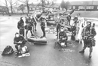 Elite group of SAS Special Air Service soldiers with their wide range of specialist equipment during a training exercise at their Regimental HQ in Hereford 1970. In the background a Gazelle reconnaissance helicopter alongside a special forces modified Land Rover is pictured. Photographed by Terry Fincher