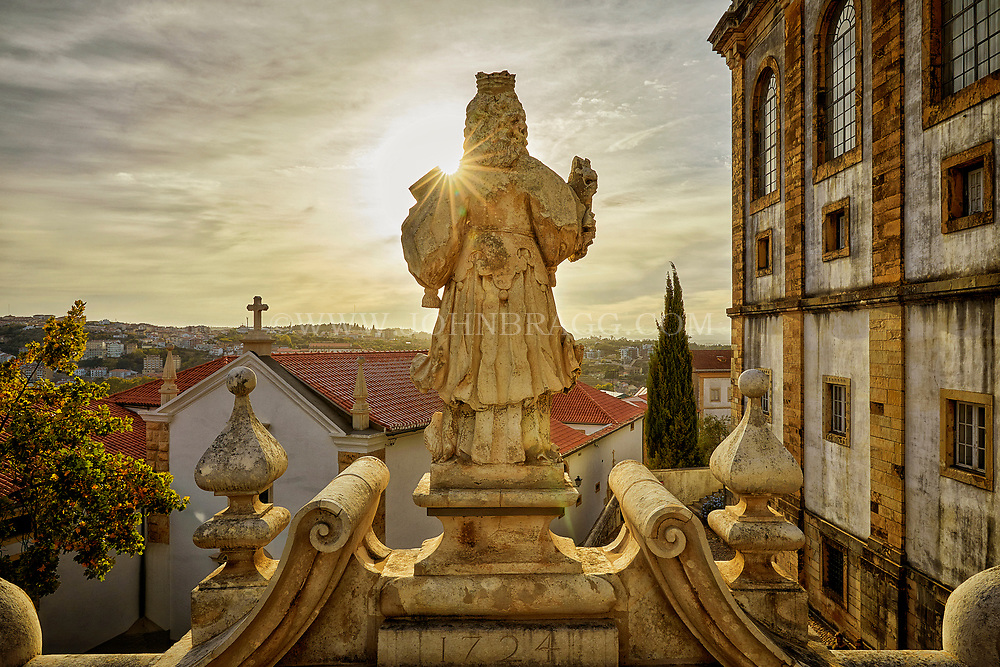 A statue faces the sun on the grounds of the University of Coimbra in central Portugal