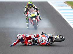 October 21, 2017 - Melbourne, Victoria, Australia - Italian rider Andrea Dovizioso (#4) of Ducati Team crashes at turn nine during the fourth free practice session at the 2017 Australian MotoGP at Phillip Island, Australia. (Credit Image: © Theo Karanikos via ZUMA Wire)