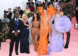 "Corey Gamble, Kris Jenner, Kim Kardashian West, Kanye West, Kendall Jenner, Kylie Jenner, and Travis Scott at the 2019 Costume Institute Benefit Gala celebrating the opening of ""Camp: Notes on Fashion"".<br />