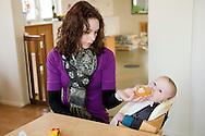 """Nederland, Herpen, 20090128...leidster geeft een baby de fles...Kinderopvang 'Op de boerderij' in Herpen...""""OP DE BOERDERIJ"""" kinderopvang..is gevestigd bij een vleesveebedrijf te Herpen.....Netherlands, Herpen, 20090128. ..kindergarten teacher gives the baby a bottle...Childcare on the farm in Herpen. ..""""ON THE FARM"""" childcare ..is located at a beef farm in Herpen.    .."""