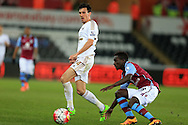 Jack Cork of Swansea city passes the ball past Idrissa Gana Gueye of Aston Villa. Barclays Premier league match, Swansea city v Aston Villa at the Liberty Stadium in Swansea, South Wales on Saturday 19th March 2016.<br /> pic by  Andrew Orchard, Andrew Orchard sports photography.