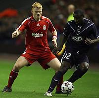 Photo: Paul Thomas.<br /> Liverpool v Bordeaux. UEFA Champions League, Group C. 31/10/2006.<br /> <br /> John Arne Riise (L) of Liverpool shadows Edixon Perea.