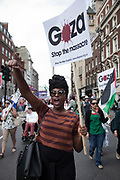 A young black woman shows her support for Gaza and the call to end the siege.<br /> <br /> Tens of thousands of protesters marched in Central London to show their outrage against the Israeli onslaught on Gaza.