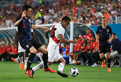 March 23, 2018 - Miami Gardens, Florida, USA - Peru defender Renato Tapia (13) battles for ball possession with Croatia forward Nikola Kalinic (16) during a FIFA World Cup 2018 preparation match between the Peru National Soccer Team and the Croatia National Soccer Team at the Hard Rock Stadium in Miami Gardens, Florida. (Credit Image: © Mario Houben via ZUMA Wire)