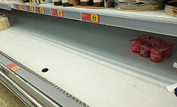© Licensed to London News Pictures. 26/09/2021. London, UK. An empty shelf of yogurt in Iceland supermarket in north London as the supply chain crisis continues. UK food producers and supermarkets are warning that shoppers are likely to face product shortages in the coming weeks after thousands of EU nationals quit their jobs as truck drivers in the UK following Brexit. According to the government, 5,000 heavy truck drivers and 5,500 poultry workers will be given working visas until Christmas 2021. Photo credit: Dinendra Haria/LNP