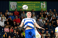 QPR defender Jimmy Dunne (20) heads the ball during the EFL Sky Bet Championship match between West Bromwich Albion and Queens Park Rangers at The Hawthorns, West Bromwich, England on 24 September 2021.