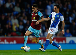 Blackburn Rovers' Peter Whittingham (right) in action with Burnley's Robbie Brady