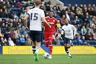 Kagisho Dikgacoi of Cardiff City runs at the Preston defence. Skybet football league championship match, Preston North End v Cardiff City at the Deepdale stadium in Preston, Lancashire on Saturday 17th October 2105.<br /> pic by Chris Stading, Andrew Orchard sports photography.