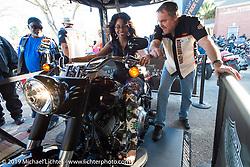 Shannon Fennicks in the HD Jumpstart display at the Biking on the Boulevard event during Daytona Bike Week. FL, USA. March 14, 2014.  Photography ©2014 Michael Lichter.