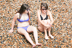 © Licensed to London News Pictures. 26/07/2014. Brighton, UK. Thousands of people relaxing and sunbathing on Brighton beach. The weather is expected to reach temperatures around the 26C in Brighton and the South Coast. Photo credit : Hugo Michiels/LNP