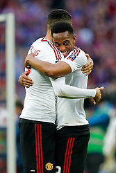Chris Smalling and Anthony Martial of Manchester United celebrate after winning the FA Cup with a 1-2 victory after the game went to extra time - Mandatory byline: Rogan Thomson/JMP - 21/05/2016 - FOOTBALL - Wembley Stadium - London, England - Crystal Palace v Manchester United - FA Cup Final.