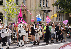 "© Licensed to London News Pictures. 30/08/2019. Bristol, UK. Extinction Rebellion Rebel Youth Alliance, The Film Industry Strikes Back event. Campaigners dressed as characters from Star Wars and the Bristol Fantasy Orchestra stage an event outside BBC Bristol Studios and the Natural History Unit calling on the film, television and theatre industries to join their cause. Extinction Rebellion have formed an alliance with the Youth Strike for Climate and are asking the film industry for help after hearing Greta Thunberg's call ""We need everyone"" for a general strike, the Global Climate Strike on 20 September. The Rebel Youth Alliance hopes the film, television and theatre industries and its trade unions BECTU and Equity will join them and together use the industry's position as a cultural leader to press for change to avoid the collapse of civilisation and the deaths of millions. Photo credit: Simon Chapman/LNP."