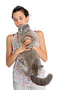 surprised owner as she holds a British Shorthair (AKA Britsh blue) cat