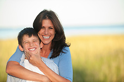 Mother and son being playful on the beach in Connecticut