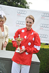 EDIE CAMPBELL holds the Magnolia Cup at the 3rd day of the 2011 Glorious Goodwood Racing Festival - Ladies Day at Goodwood Racecourse, West Sussex on 28th July 2011.