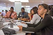 Purchase, NY – 31 October 2014. Sadé Whittier, right, and part of the team from Alexander Hamilton High School working on their case study. Alexander Hamilton High School placed third in the 2014 competition. The Business Skills Olympics was founded by the African American Men of Westchester, is sponsored and facilitated by Morgan Stanley, and is open to high school teams in Westchester County.