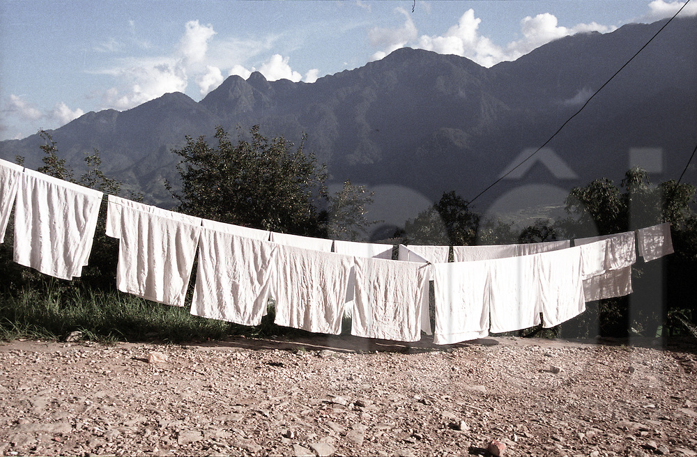 Clothesline along a track with a mountainous background behind. Sapa, Vietnam, Southeast Asia