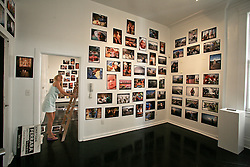 September 15 2006 - New Orleans, Louisiana. Jonathan Ferrara Gallery. 'Katrina 366 - A year and a day in the life of New Orleans' Setting up the show in the hours before doors opened to the public. Last minute chaos!