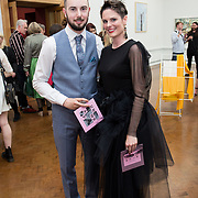 """18.05.2018.          <br /> More than 500 people attended the flagship event of the inaugural Unwrap LSAD Fashion Festival in Limerick.<br /> <br /> Pictured at the event were, Nigel Enright and Roisin Ni Loinsigh.<br /> <br /> The Limerick School of Art & Design, LIT, Fashion Design Graduate Exhibition and launch of the """"The Fashion Film"""" at Limerick City Gallery of Art, in partnership with EVA International, attracted hundreds of people from the world of fashion. <br /> <br /> A total of 27 fashion graduates presented their designs alongside the specially commissioned film by fashion stylist and creative director Kieran Kilgallon and videographer Albert Hooi. Picture: Alan Place"""